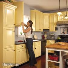 best roller for painting kitchen cabinets how to spray paint kitchen cabinets the family handyman