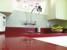i love our new red sparkly quartz countertops paired with our