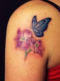 blue butterfly and pink flower on back shoulder