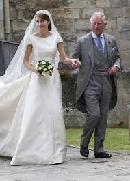 prince charles gives away a blushing bride at wedding where queen