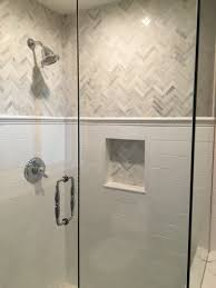 love the this shower and the gray and white tile chevron marble