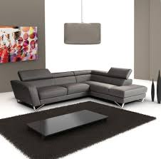 l shape gray leather sleeper sofa with high backrest and metal