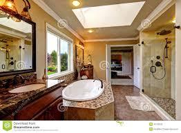 mosaic glass door luxury bathroom interior with bath tub and glass door shower stock