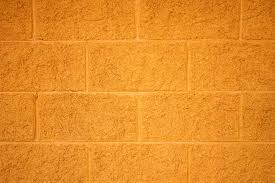 free picture yellow painted bricks cinder block wall texture