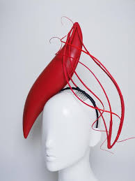 s headband wind and leather s shaped headband with ostrich quill detial