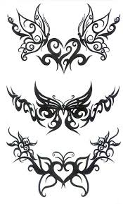 tribal butterfly tattoo set for lower back photo 2 real photo