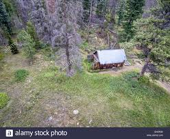 aerial view of ruins of a rustic cabin along old flowers road in