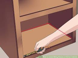 How To Install Sliding Shelves In Kitchen Cabinets With Pictures - Kitchen cabinet sliding drawers