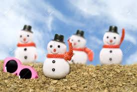 snowmen ornaments on a gravel with pink sunglasses
