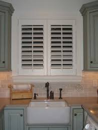 kitchen window shutters interior arched eyebrow windows are no problem for plantation shutters