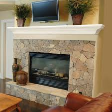 white concrete shelf on stone design of fireplace with houseplants