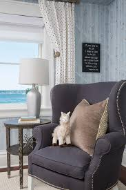blue and gray nursery with wingback chair transitional nursery