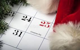 christmas calendar santa hat laying on a christmas calendar stock photo image of