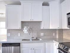 white kitchen with backsplash smoke glass subway tile white shaker cabinets shaker cabinets