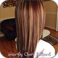 brunette hairstyle with lots of hilights for over 50 dark hair with highlights black hair with brown red highlights