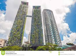 eco architecture green skyscraper building with plants growing on