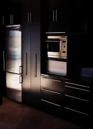 black stain on kitchen cabinets painting or staining kitchen cabinets in black onyx