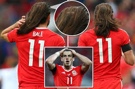 bale needs a hair cut gareth bale lets his hair down during wales disappointing 1 1