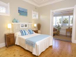 neutral cream wall paint color background with blue beach bedroom