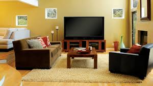caramel color paint for living room with brown sofa and dark