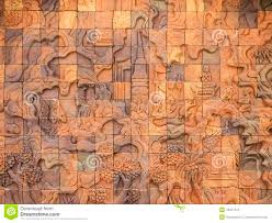 carved wall sculpture in the temple of thailand stock image