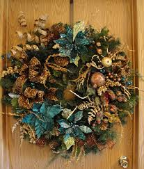 beautiful evergreen christmas wreath with teal poinsettias gold