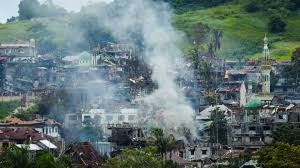 siege social leader price islamist militants hang on in philippine city siege 24