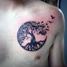 mens upper chest birds flying circle tree of life tattoo tatts