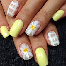 pastel yellow nails minus the pearl designs tho not my style