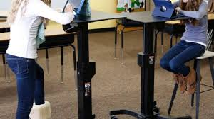 Stand Up Desk Exercises Students Use Standing Desks Exercise Equipment To Boost Learning