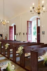 Church Pew Home Decor Clusters Of White Dendrobium Orchids Tied With Satin Ribbons Adorn