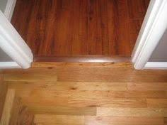 Laminate Flooring Kitchen by Go In Two Different Directions Laminate Flooring Two Rooms Meet