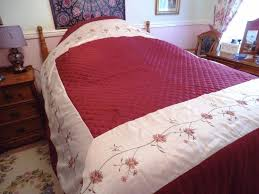 bedspread from dunelm burgundy and cream fits double and some