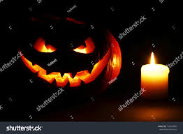 halloween pumpkins background halloween pumpkin scary face burning candle stock photo 156746885