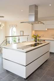 granite countertop cream cabinet kitchens glass backsplash in
