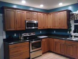 blue kitchen walls with brown cabinets my kitchen remodel granite cherry cabinets teal