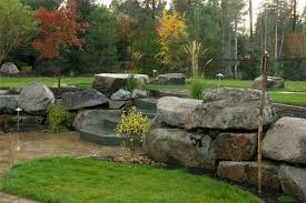 fake rock boulders landscaping ideas to use fake rocks for