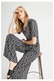 jumpsuit in jumpsuits rima abstract jumpsuit in black