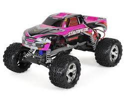 bigfoot and the mighty monster trucks rustler 1 10 rtr stadium truck pink by traxxas tra37054 1 pink