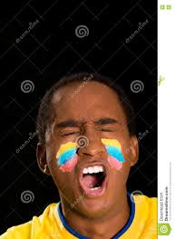 halloween face paint kids black background headshot dark skinned male wearing yellow football shirt in front