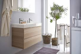 A Bathroom With White Wall Tiles Grey Floor Tiles And Two Black - Ikea bathroom design