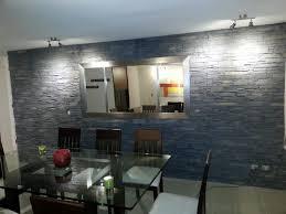 naturstein wohnzimmer haus renovierung mit modernem innenarchitektur kühles steinwand