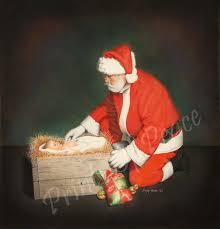 santa kneeling at the manger santa with child christmas painting santa jesus
