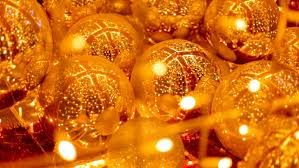 large gold mirror balls reflect the sparkling lights