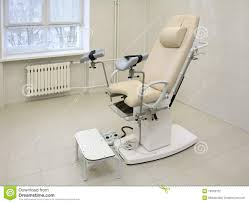 gynecological chair in a medical office stock photography image