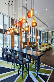 modern pendant lighting for your kitchen traba homes enthralling dining room with colorful modern pendant lighting above black rectangle wooden table