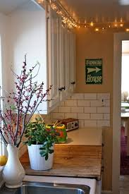top of kitchen cabinet greenery 14 ideas for decorating space above kitchen cabinets how