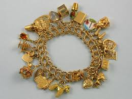 bracelet charm gold images The love nest charmed i 39 m sure a collection of charm bracelets jpg