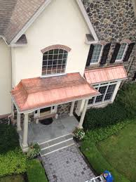 concave standing seam copper metal roof with flat seam soldered
