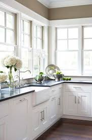 17 Best Ideas About Black White Kitchens On Pinterest by Distressed Antique White Kitchen Cabinets Cliff Kitchen